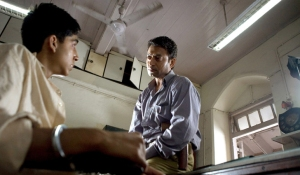 "Jamal is questioned by fraud detective in ""Slumdog Millionaire"""